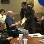Active duty Air Force Pilot Tony Cannone presenting a certificate.
