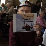 Ed with one of his photo shopped pics from a hobby of his, para sailing. He wind surfed up until he was 94!